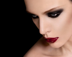 Face of a beautiful young woman wearing dark makeupの写真素材 [FYI03614577]