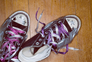 Girl's shoes with metallic lacesの写真素材 [FYI03614638]