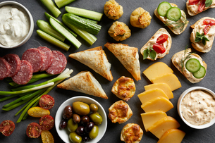 Appetiser snack spread with open sandwiches, olives and cheese , overhead viewの写真素材 [FYI03615413]