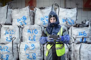 Portrait of worker in recycling factoryの写真素材 [FYI03615461]