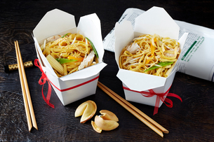 Still life with chinese noodles in takeaway boxes, asian takeaway foodの写真素材 [FYI03615530]