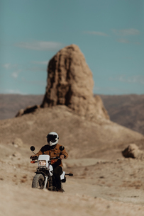 Motorcyclist riding in desert, Trona Pinnacles, California, USの写真素材 [FYI03616860]