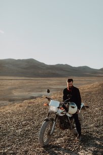 Motorcyclist on stationary bike, Trona Pinnacles, California, USの写真素材 [FYI03616870]
