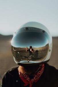 Motorcyclist's reflection on friend's helmet, Trona Pinnacles, California, USの写真素材 [FYI03616872]