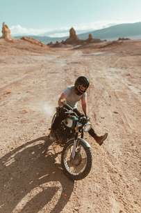Motorcyclist enjoying stunts, Trona Pinnacles, California, USの写真素材 [FYI03616905]