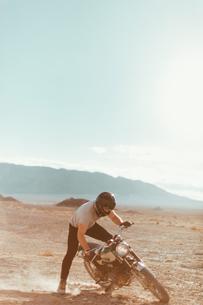 Motorcyclist enjoying stunts, Trona Pinnacles, California, USの写真素材 [FYI03616907]