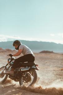 Motorcyclist enjoying stunts, Trona Pinnacles, California, USの写真素材 [FYI03616908]