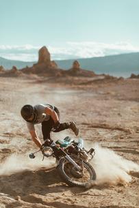 Motorcyclist enjoying stunts, Trona Pinnacles, California, USの写真素材 [FYI03616911]
