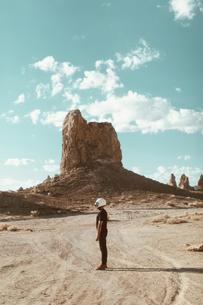 Motorcyclist standing in desert, Trona Pinnacles, California, USの写真素材 [FYI03616918]