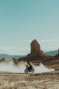 Motorcyclist riding in desert, Trona Pinnacles, California, USの写真素材 [FYI03616919]