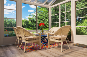Beige wicker armchairs and blue wooden table in sunroomの写真素材 [FYI03617128]