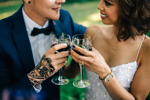 Bride and groom raising a glass in forest, croppedの写真素材 [FYI03617733]