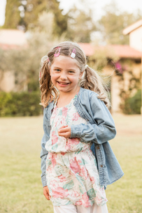 Cute girl with pigtails in garden, portrait, Portoferraio, Tuscany, Italyの写真素材 [FYI03618294]