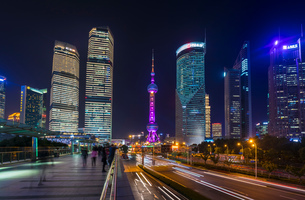 Pudong skyline and Oriental Pearl Tower from elevated walkway at night, Shanghai, Chinaの写真素材 [FYI03618379]