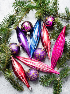 Colourful vintage glass bulbs with twig of Christmas treeの写真素材 [FYI03618407]