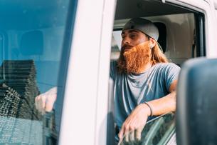 Man in commercial vehicle in industrial yardの写真素材 [FYI03618871]