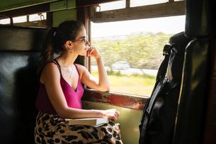 Woman on local train, Galle, South Coast, Sri Lankaの写真素材 [FYI03619719]