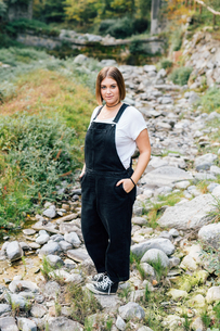 Woman standing in dry riverbed, Rezzago, Lombardy, Italyの写真素材 [FYI03619822]