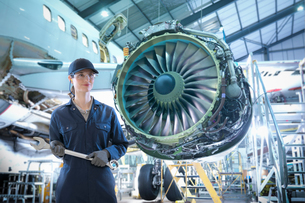 Composite image of female worker in aircraft maintenance factoryの写真素材 [FYI03620375]