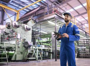 Composite image of worker in carbon fibre factoryの写真素材 [FYI03620393]