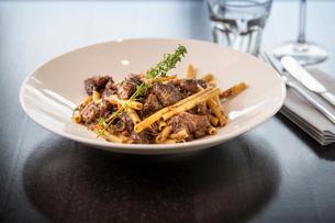 Beef pasta dish at Italian Restaurantの写真素材 [FYI03620602]
