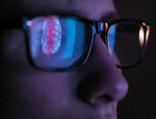 Cyber Security, reflection in spectacles  of access information being scanned on computer screen, clの写真素材 [FYI03620875]