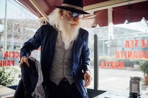 Senior businessman sitting down in cafe, Milano, Lombardia, Italyの写真素材 [FYI03621349]