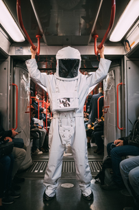 Astronaut travelling in trainの写真素材 [FYI03621363]