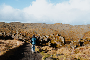 Tourist hiking on trail between lava rocks, Stykkishmur, Snafellsnes- og Hnappadalssysla, Icelandの写真素材 [FYI03621817]