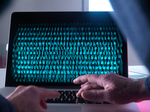Cyber Crime, laptop computer being hackedの写真素材 [FYI03622162]