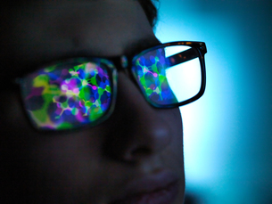 Biotechnology research, computer screen reflection in spectacles of new molecular formula in laboratの写真素材 [FYI03622196]