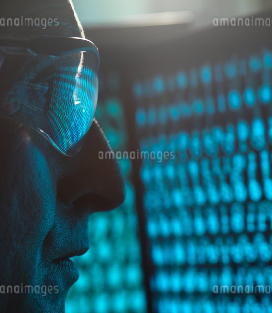 Cyber Security, Man looking at computer screen which is being infected by a virus, close upの写真素材 [FYI03622607]