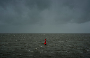 Seascape with heavy rain and hail over the Waddensea in winter, Hollum, Friesland, Netherlandsの写真素材 [FYI03622678]