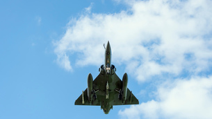 French Mirage 2000 fighter plane taking part in NATO exercise Frysian flag, low angle against blue sの写真素材 [FYI03622690]