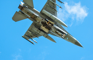Dutch F-16 fighter plane taking part in NATO exercise Frysian flag, low angle against blue sky, Nethの写真素材 [FYI03622693]
