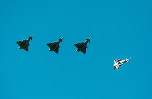 German Eurofighter Typhoon fighter planes taking part in NATO exercise Frysian flag, low angle againの写真素材 [FYI03622695]