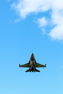 Polish F-16 fighter plane taking part in NATO exercise Frysian flag, low angle against blue sky, Netの写真素材 [FYI03622698]