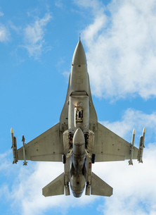 Polish F-16 fighter plane taking part in NATO exercise Frysian flag, low angle against blue sky, Netの写真素材 [FYI03622699]