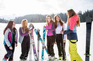 Five teenage girl skiers chatting in snow covered landscape, Tyrol, Styria, Austriaの写真素材 [FYI03622899]