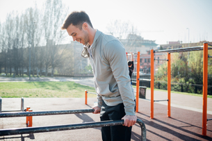 Calisthenics at outdoor gym, young man on parallel barsの写真素材 [FYI03622996]