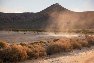 Helicopter landing in dusty rural landscape, Cape Town, Western Cape, South Africaの写真素材 [FYI03624219]