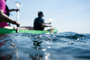 Teenage boy and mother sea kayaking, surface level shallow focus side view, Limnos, Khios, Greeceの写真素材 [FYI03624367]