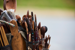 Tool belt filled with wooden spoons and knivesの写真素材 [FYI03624523]