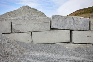 Gravel and concrete blocks stacked on construction site, Big Sur, California, USAの写真素材 [FYI03624605]
