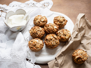 Still life of wholemeal muffins on plate with bowl of soft cheese, overhead viewの写真素材 [FYI03625903]
