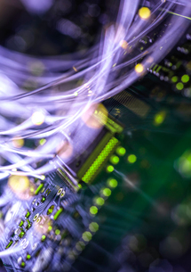 Fibre optics carrying data passing through electronic circuit boards, close upの写真素材 [FYI03626645]