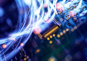 Fibre optics carrying data passing through electronic circuit boards, close upの写真素材 [FYI03626646]