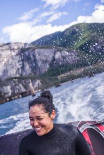 Woman travelling on speedboat, Squamish, Canadaの写真素材 [FYI03626686]