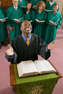 Happy preacher with Bible at church altar looking up  highの写真素材 [FYI03627117]