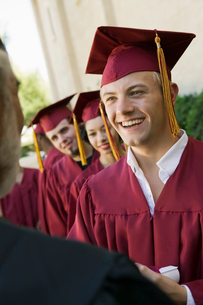 Graduates in line for degree outsideの写真素材 [FYI03627212]